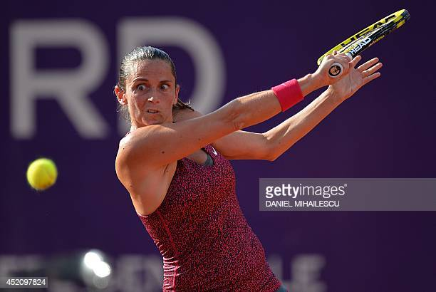 Italy's Roberta Vinci eyes the ball during the single final at the WTA Bucharest tennis tournament in Bucharest on July 13 2014 Halep won against...