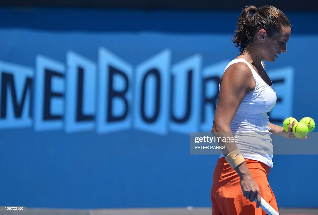 Italy's Roberta Vinci prepares to serve against Russia's Elena Vesnina during their women's singles match on day six of the Australian Open tennis tournament in Melbourne on January 19, 2013.