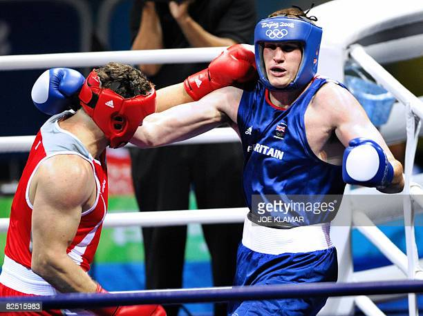 Italy's Roberto Cammarelle fights against Great Britain's David Price during their 2008 Olympic Games Super Heavyweight semifinal boxing bout on...