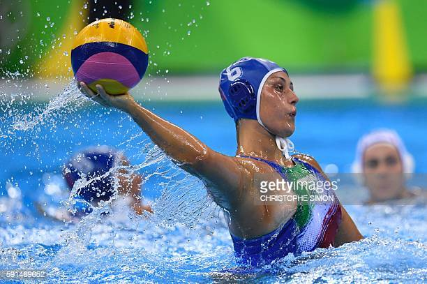 Italy's Rosaria Aiello arms the ball to score during their Rio 2016 Olympic Games women's water polo semifinal game at the Olympic Aquatics Stadium...