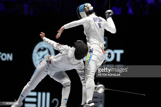 Italy's Rossella Fiamingo and Ukraine's Olena Kryvytska compete in the women's Epee Team event for the third place at the 2019 Fencing World...