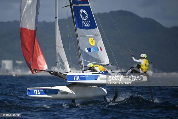 Italy's Ruggero Tita and Caterina Banti compete in the mixed multihull Nacra 17 foiling race during the Tokyo 2020 Olympic Games sailing competition...