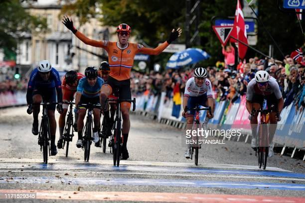 Italy's Samuele Battistella Netherlands' Nils Eekhoff Britain's Thomas Pidcock and Switzerland's Stefan Bissegger cross the finish line of the Men's...