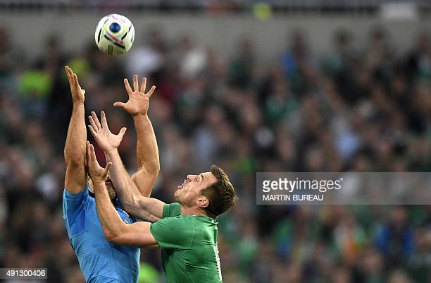 Italy's scrum half Edoardo Gori and Ireland's wing Tommy Bowe jump for the ball during a Pool D match of the 2015 Rugby World Cup between Ireland and...