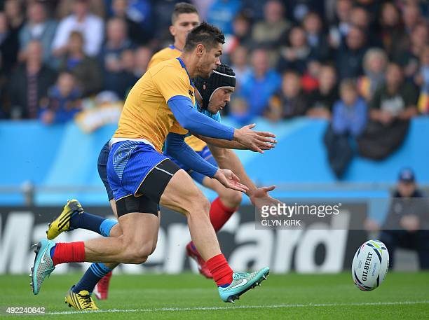 Italy's scrum half Edoardo Gori and Romania's fullback Catalin Fercu run for the ball in Romania's try area during a Pool D match of the 2015 Rugby...