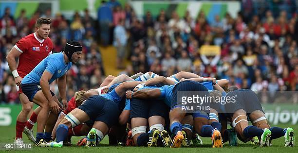 Italy's scrum half Edoardo Gori feeds the ball into a scrum next to Canada's scrum half Jamie Mackenzie during a Pool D match of the 2015 Rugby World...