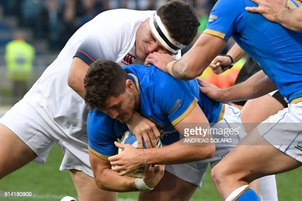 Italy's scrumhalf Marcello Violi vies for the ball with England's hooker Jamie George during the Six Nations rugby union match between Italy and...