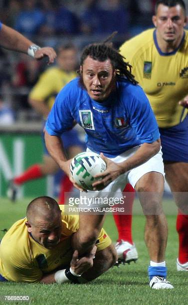 Italy's scrum-half Paul Griffen tries to pass the ball despite Romania's hooker Marius Tincu during the rugby union World Cup group C match between...