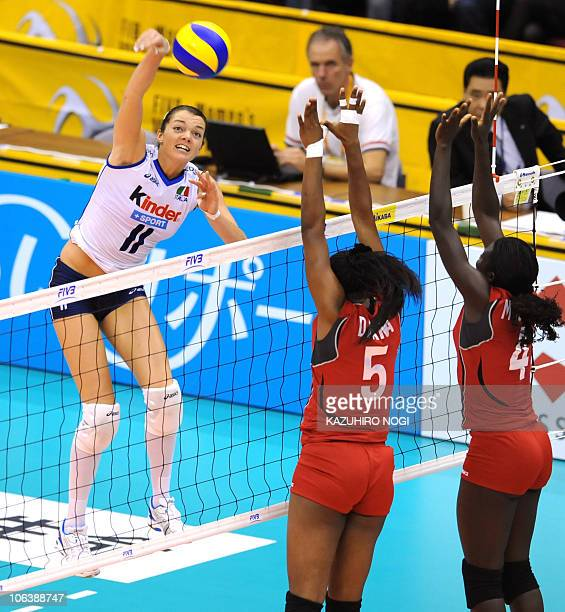 Italy's Serena Ortolani attacks against Kenya's Diana Khisa and Esther Mwombe during their first round match of the world women's volleyball...