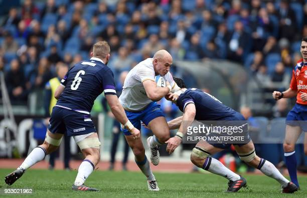 TOPSHOT Italy's Sergio Parisse vies with Scotland Tim Swinson during the Six Nations international rugby union match between Italy and Scotland at...