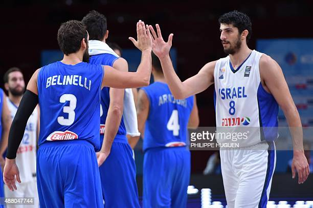 Italy's shooting guard Marco Belinelli and Israel's small forward Lior Eliyahu greet after Italy defeated Israel in their round of 16 basketball...