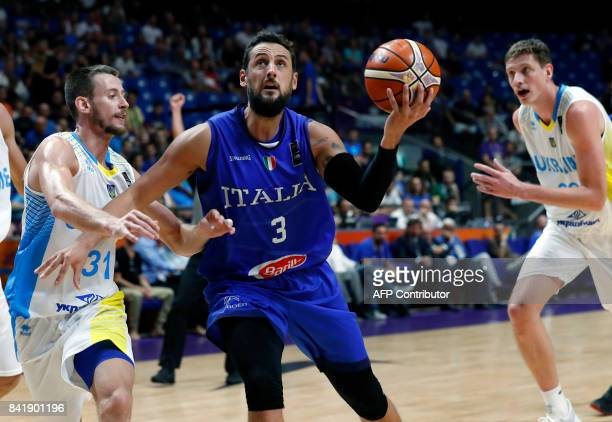 Italy's shooting guard Maro Belinelli is marked by Ukraine's point guard Oleksandr Mishula during their FIBA EuroBasket 2017 basketball championship...