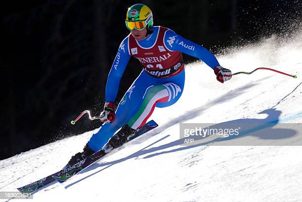 Italy's Siegmar Klotz competes during the men's SuperG race at the FIS Ski World Cup on March 3 2013 in Kvitfjell Norway Norway's Aksel Lund Svindal...