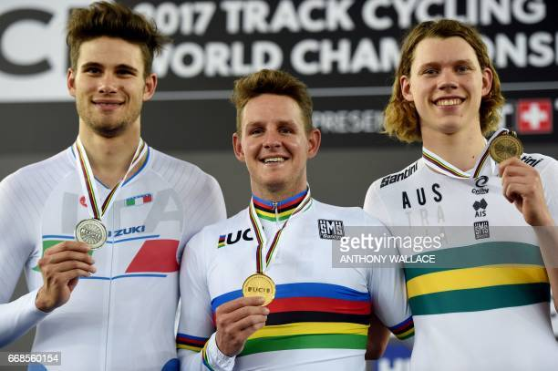 Italy's silver medalist Filippo Ganna Australia's gold medalist Jordan Kerby and Australia's bronze medalist Kelland O'Brien celebrate during the...