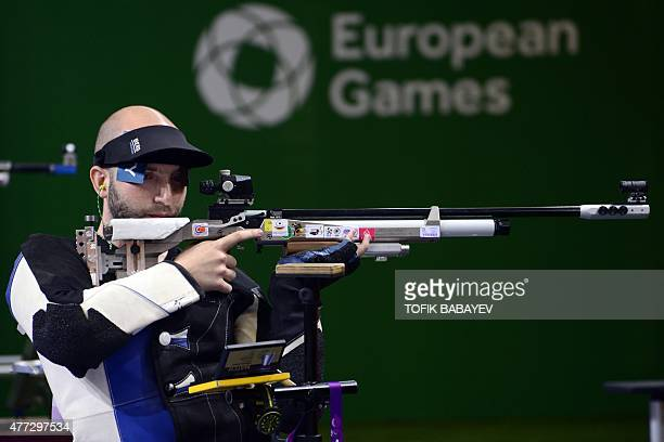 Italy's silver medalist Niccolo Campriani competes in the men's 10m air rifle final during the 2015 European Games in Baku on June 16 2015 AFP PHOTO...