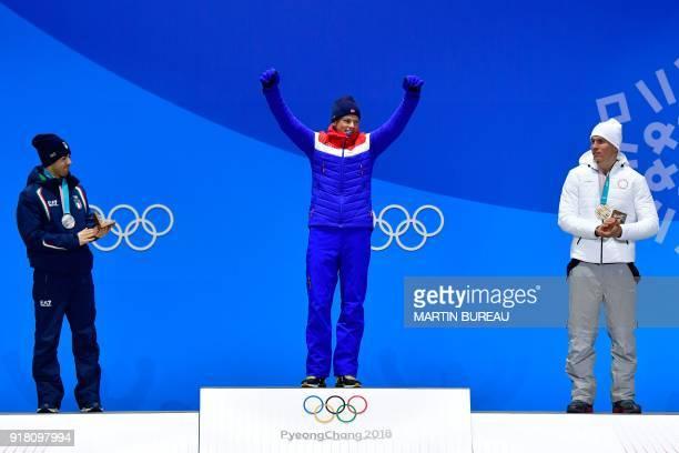 Italy's silver medallist Federico Pellegrino Norway's gold medallist Johannes Hoesflot Klaebo and Russia's bronze medallist Alexander Bolshunov pose...