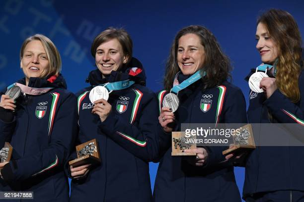 Italy's silver medallists Arianna Fontana Lucia Peretti Cecilia Maffei and Martina Valcepina pose on the podium during the medal ceremony for the...