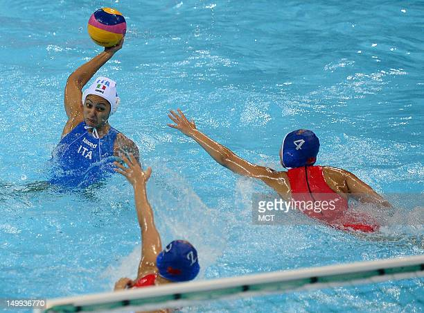 Italy's Simona Abbate left takes aim at the China's goal against China defender Yujun Sun and Fei Teng in the second half a women's water polo...