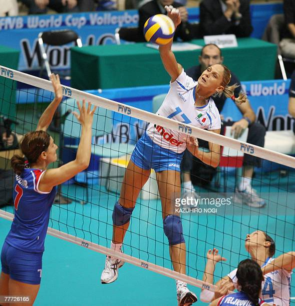 Italy's Simona Gioli spikes the ball over Serbian blocker Brizitka Mohnar during their second round match in the women's World Cup volleyball...
