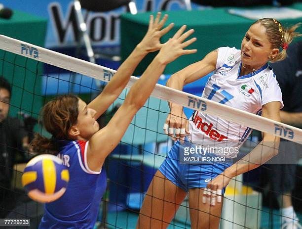 Italy's Simona Gioli spikes the ball over Serbian blocker Brizitka Mohnar during their second round match at the women's World Cup volleyball...