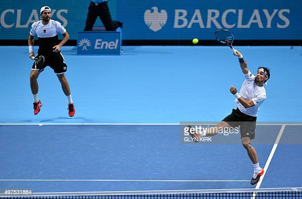 Italy's Simone Bolelli and Fabio Fognini in their match against US player Mike Bryan and US player Bob Bryan during their men's doubles group stage...