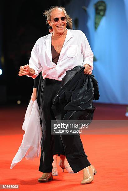 Italy's singer and director Adriano Celentano dances before the screening of his movie Yuppi Du at the 65th Venice International Film Festival in...