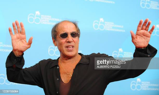 Italy's singer and director Adriano Celentano poses during the photocall of his movie Yuppi Du at the 65th Venice International Film Festival in...