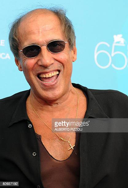 "Italy's singer and director Adriano Celentano poses during the photocall of his movie ""Yuppi Du"" at the 65th Venice International Film Festival in..."