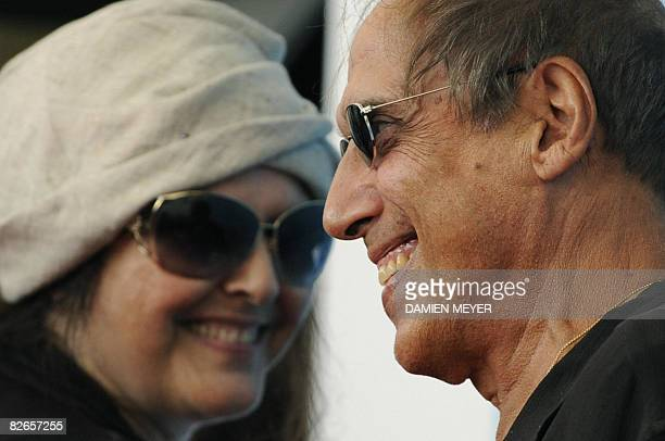 Italy's singer and director Adriano Celentano poses with his wife Claudia Mori during the photocall of his movie Yuppi Du at the 65th Venice...