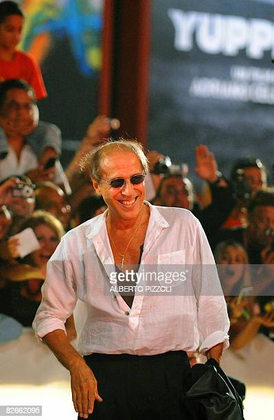 Italy's singer and director Adriano Celentano smiles before the screening of his movie Yuppi Du at the 65th Venice International Film Festival in...