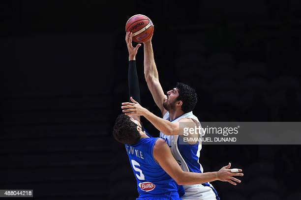 Italy's small forward Alessandro Gentile defends against Israel's small forward Lior Eliyahu during the round of 16 basketball match between Israel...