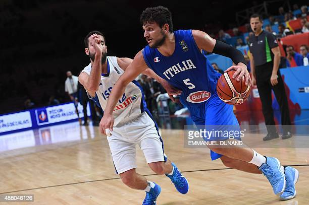 Italy's small forward Alessandro Gentile dribbles around Israel's point guard Yogev Ohayon during the round of 16 basketball match between Israel and...