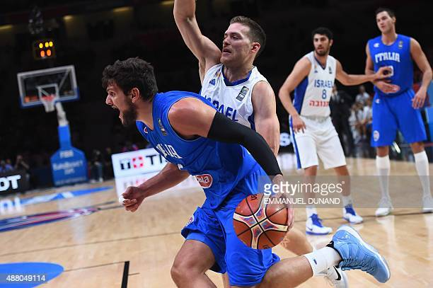 Italy's small forward Alessandro Gentile dribbles around Israel's point guard Gal Mekel during the round of 16 basketball match between Israel and...