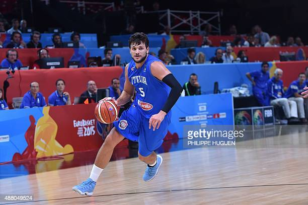 Italy's small forward Alessandro Gentile dribbles during the round of 16 basketball match between Israel and Italy at the EuroBasket 2015 in Lille...