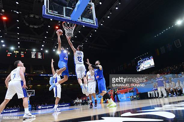 Italy's small forward Alessandro Gentile goes to the basket despite Israel's point guard Yogev Ohayon during the round of 16 basketball match between...