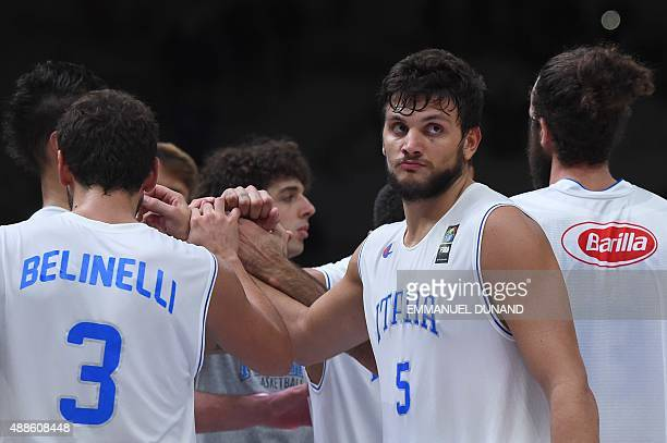 Italy's small forward Alessandro Gentile reacts after Lithuania defeated Italy in their round of 8 basketball match at the EuroBasket 2015 in Lille...