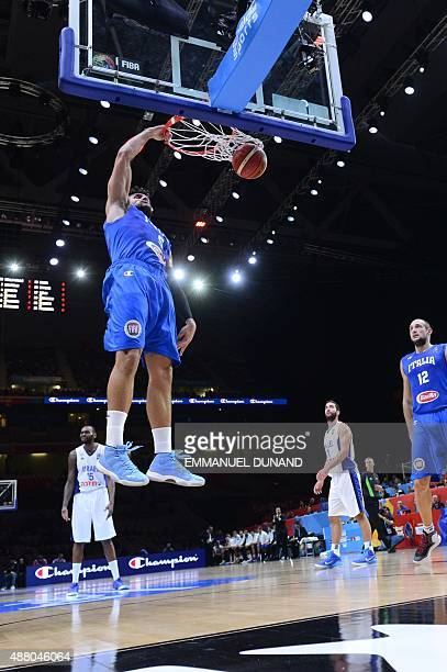 Italy's small forward Alessandro Gentile slams a dunk during the round of 16 basketball match between Israel and Italy at the EuroBasket 2015 in...