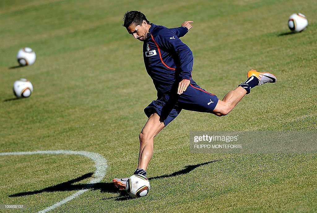 Italy's soccer team forward Marco Borriello shoots the ball during a training session in Sestriere on May 25, 2010. The Italian team started today a retreat in the mountains of Sestriere before the FIFA World Cup 2010 in South Africa .AFP PHOTO / Filippo MONTEFORTE