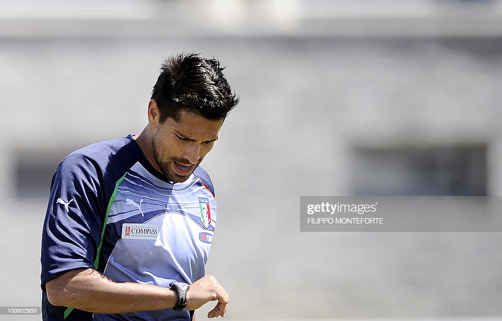 Italy's soccer team's forward Marco Borriello controls his cardiometer during a training session in Sestriere on May 25, 2010. The Italian team stays for a retreat in the mountains of Sestriere before the FIFA World Cup 2010 in South Africa .AFP PHOTO / Filippo MONTEFORTE