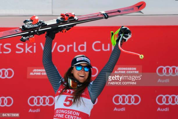 Italy's Sofia Goggia reacts on the podium after winning the women's downhill race at the FIS Alpine Ski World Cup in Jeongseon some 150km east of...
