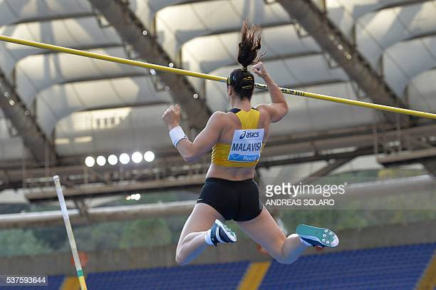 Italy's Sonia Malavisi competes in the Women's Pole Vault event at the Rome's Diamond League competition on June 2 2016 at the Olympic Stadium in...