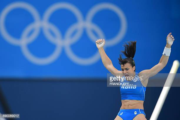Italy's Sonia Malavisi competes in the Women's Pole Vault Qualifying Round during the athletics competition at the Rio 2016 Olympic Games at the...