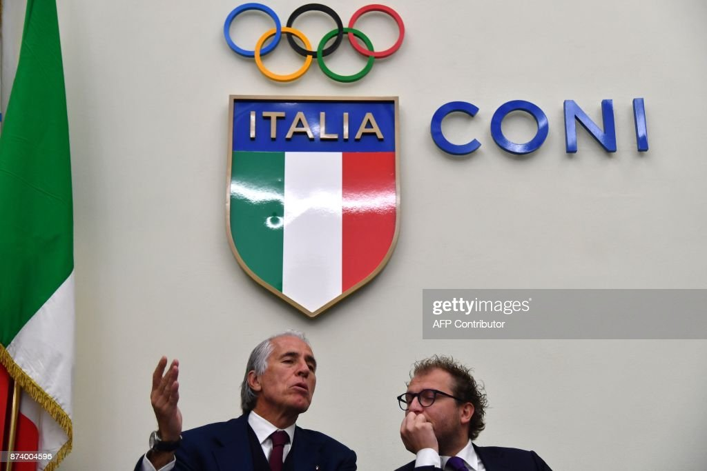 Italy's Sport Minister Luca Lotti (R) and the president of the Italian Olympic Committee (CONI), Giovanni Malago give a press conference a day after the elimination of Italy during the FIFA World Cup 2018 qualification football match against Sweden, on November 14, 2017 at the Foro Italico in Rome. Italy failed to reach the World Cup for the first time since 1958 on Monday as they were held to a 0-0 draw in the second leg of their play-off at the San Siro by Sweden, who qualified with a 1-0 aggregate victory. / AFP PHOTO / Alberto PIZZOLI