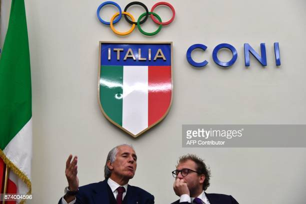 Italy's Sport Minister Luca Lotti and the president of the Italian Olympic Committee Giovanni Malago give a press conference a day after the...