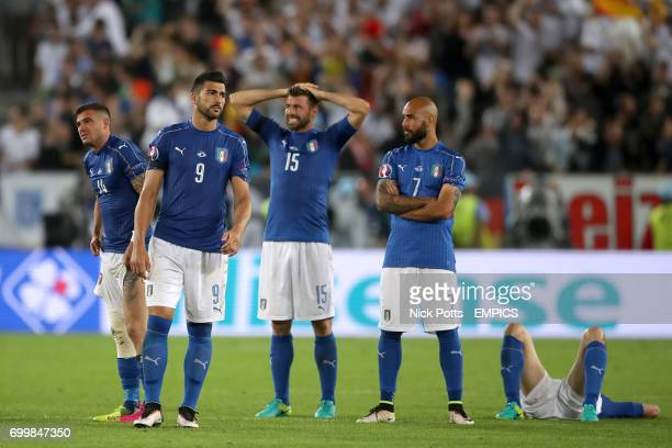 Italy's Stefano Sturaro Graziano Pelle Andrea Barzagli and Simone Zaza stand dejected after losing the penalty shootout