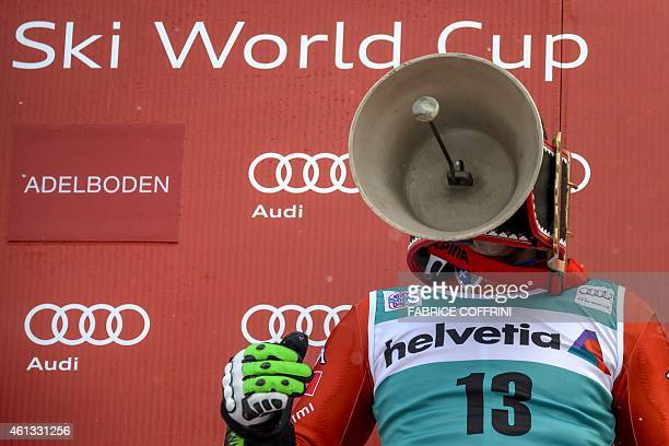 Italy's Stephano Gross celebrates his first World Cup victory with a cow bell during the podium ceremony of the men's slalom race at the FIS Alpine...