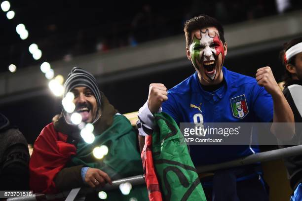 Italy's supporters pose prior the FIFA World Cup 2018 qualification football match between Italy and Sweden on November 13 2017 at the San Siro...