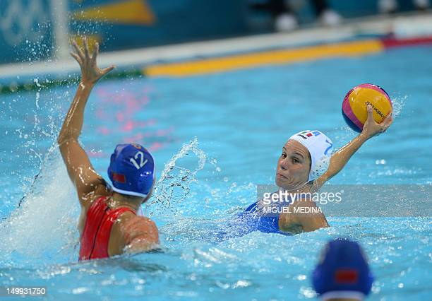 Italy's Tania di Mario is challenged by China's Zhang Lei during the women's Water Polo classification 5th/8th round match between Italy and China of...