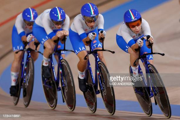 Italy's team compete in the first round heats of the women's track cycling team pursuit event during the Tokyo 2020 Olympic Games at Izu Velodrome in...