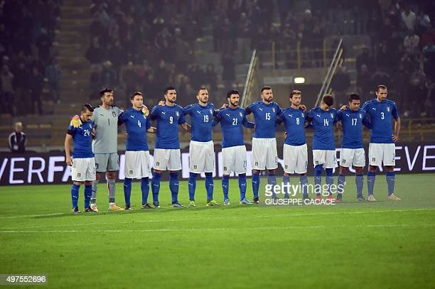 Italy's team observes a minute of silence in tribute to the victims of the Paris terrorist attacks before the friendly football match between Italy...